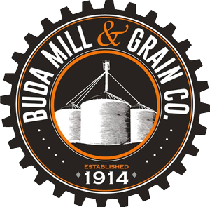 Brown, orange and white gear shape logo with grain silos for Buda Mill & Grain Established in 1914 - Buda Texas